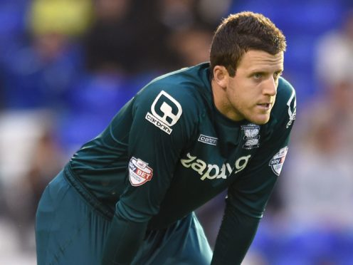 Kilmarnock keeper Colin Doyle had to make a couple of vital saves to keep his team in their play-off tie with Dundee (Joe Giddens/PA)