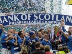 Rangers' players celebrate with the SPL Trophy after defeating Hibernian 1-0 (PA).