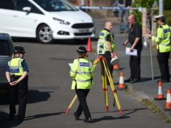 Police survey the scene in Meadow Close in the Trench area of Telford, where the former Aston Villa footballer died after he was Tasered by police (PA)