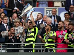 Christopher Schindler, holding trophy, helped Huddersfield win promotion to the Premier League via the play-offs in 2017 (Nick Potts/PA)