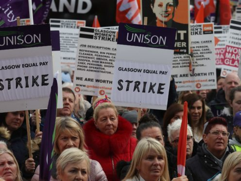 Strikers outside Glasgow Council's city chambers in George Square (PA)