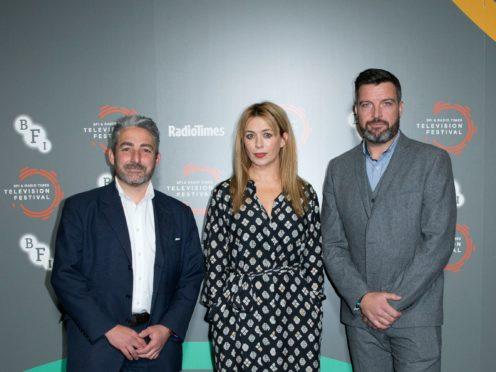 Keeping Faith's creator and writer Matthew Hall (left) with stars Eve Myles and Bradley Freegard (Handout/PA)