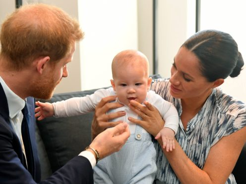 The Duke and Duchess of Sussex with Archie (Toby Melville/PA)