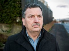 John Teggart, standing in the Ballymurphy area of west Belfast (Liam McBurney/PA)