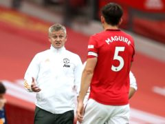 Manchester United manager Ole Gunnar Solskjaer (left) is hopeful of having captain Harry Maguire fit for the Europa League final (Martin Rickett/PA)