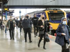 Commuters at Leeds railway station (Danny Lawson/PA)