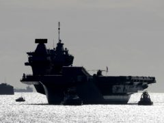 The Royal Navy aircraft carrier HMS Queen Elizabeth (Gareth Fuller/PA)