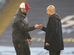 Jurgen Klopp (left) called Pep Guardiola the best manager in the world as he congratulated City on their title (Martin Rickett/PA)
