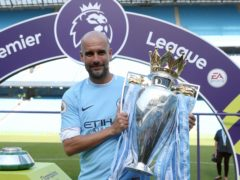 Pep Guardiola is making a habit of winning trophies at Manchester City (Martin Rickett/PA)