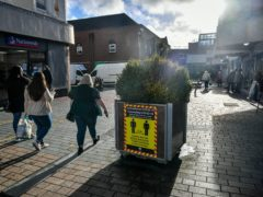Shoppers in Merthyr Tydfil, the area with the highest seven-day coronavirus case rate in Wales (Ben Birchall/PA)
