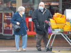 Shoppers wearing face masks outside a Sainsbury's store in south east London (PA)
