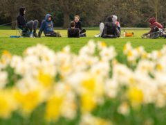People observe social distancing as they meet up in Greenwich Park (PA)