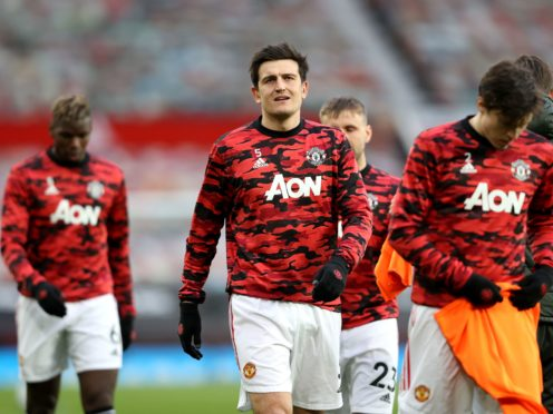 Harry Maguire and his Manchester United team-mates face a punishing schedule over the next week (Clive Brunskill/PA)