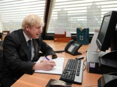 Boris Johnson said the intention is to lift the working from home guidance on June 21 (Stefan Rousseau/PA)
