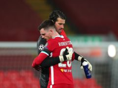 Alisson, left, has the support of Andy Robertson, right, and his Liverpool team-mates (Peter Byrne/PA)