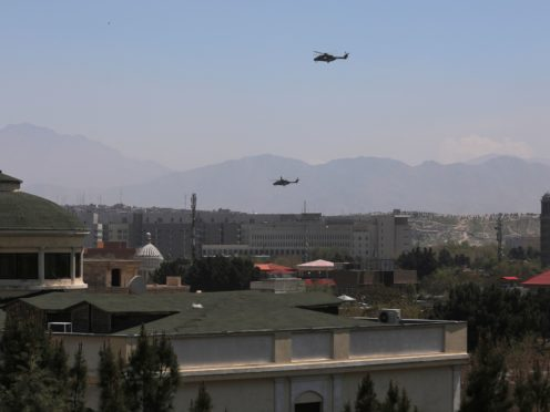 US Black Hawk military helicopters fly over the Afghan capital (AP)