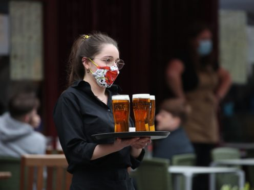 Businesses like pubs that had been closed since the new year were allowed to welcome customers back in April (Andrew Milligan/PA)