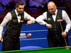 Mark Selby (left) and Stuart Bingham are set for a late-night return (Zac Goodwin/PA)