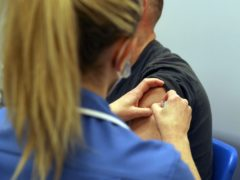 Someone receiving a coronavirus jab (PA)