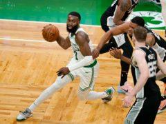 Boston Celtics guard Jaylen Brown (7) drives to the basket (Elise Amendola/AP)