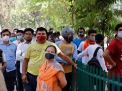 People queue for vaccines at a medical facility in Prayagraj, India (Rajesh Kumar Singh/AP)