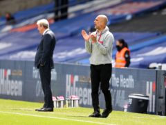 Pep Guardiola saw Manchester City take another step towards the title with a 2-0 win at Crystal Palace (Catherine Ivill/PA)
