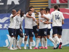 Manchester City players celebrate Sergio Aguero's goal against Crystal Palace (Clive Rose/PA)