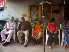 Covid-19 patients receive oxygen outside a Sikh house of worship in New Delhi on Saturday (Amit Sharma/AP)