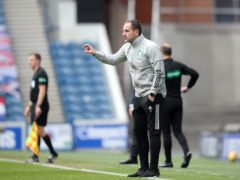 Celtic interim manager John Kennedy blamed referee Nick Welsh for sending off Callum McGregor after the 4-1 Old Firm defeat against Rangers (Jane Barlow/PA Images).