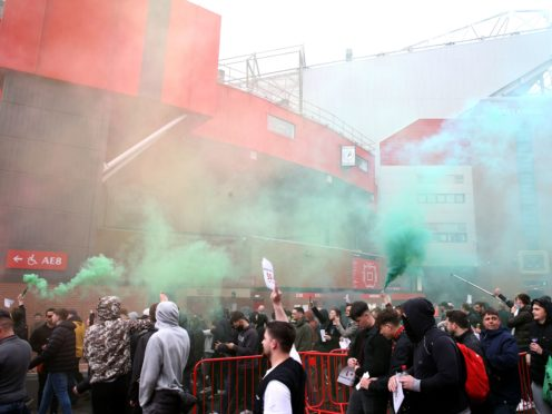 Manchester United fans protest against the club's owners outside Old Trafford on Sunday (PA)