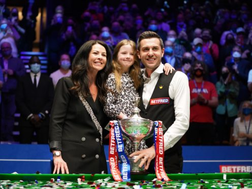 Mark Selby celebrates with his wife and daughter after winning the world title for a fourth time (Zac Goodwin/PA).