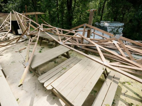 Rubble remains of the Ridge, a pavilion used by members of Parkview Church of God, after a direct hit by a tornado, Monday, May 3, 2021, in Yazoo County, Miss. A spate of tornadoes hit communities throughout the state on Sunday. (AP Photo/Rogelio V. Solis)