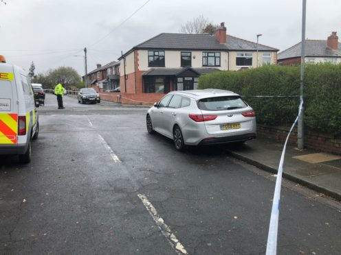 A police cordon in place at Walker Avenue in Bolton where a 15-year-old boy was stabbed several times. Greater Manchester Police said he had suffered several stab wounds and was taken to hospital but died from his injuries. Picture date: Tuesday May 4, 2021.