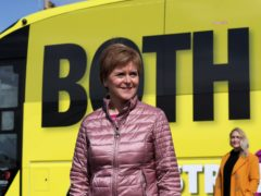 Nicola Sturgeon urged Scots to back her to take the country through the Covid pandemic and into a 'brighter future' (Russell Cheyne/PA)