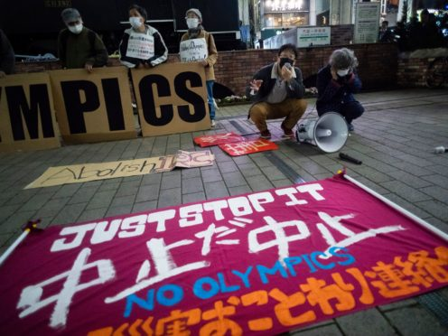 A banner opposing the Olympics is placed by protesters in Tokyo (AP)