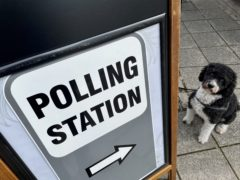 Henry the six-year-old labradoodle outside a polling station near the SS Great Britain on Brunel Square in Bristol (Claire Hayhurst/PA)