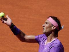 Rafael Nadal prepares to serve to Alexei Popyrin (Paul White/AP)