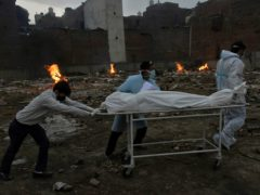 The body of a COVID-19 victim is wheeled into a converted crematorium in New Delhi (AP)