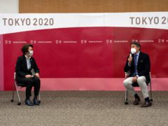 Seiko Hashimoto, president of the Tokyo 2020 Organizing Committee, left, listens during a meeting with Sebastian Coe, president of World Athletics, Friday, May 7, 2021 in Tokyo, Japan. (Carl Court/Pool Photo via AP)
