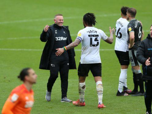 Derby manager Wayne Rooney, left, celebrates with Colin Kazim-Richards (Nigel French/PA)