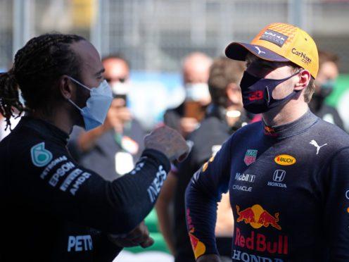 Lewis Hamilton celebrated 100 pole positions on Saturday (Emilio Morenatti/AP)