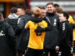 Cambridge manager Michael Bonner (centre) and Liam O'Neil celebrate (Tim Goode/PA)
