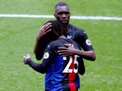 Goalscorers Christian Benteke, top, and Eberechi Eze embrace following Eze's late clincher (Alex Livesey/PA)
