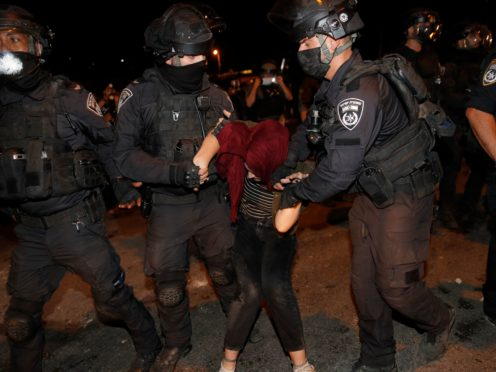 Israeli police officers detain a Palestinian demonstrator during a protest against the planned evictions of Palestinian families in the Sheikh Jarrah neighbourhood of east Jerusalem (Oded Balilty/AP)