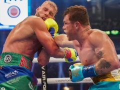 Canelo Alvarez, right, landed a telling blow on Billy Joe Saunders (AP Photo/Jeffrey McWhorter)