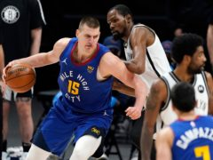 Denver Nuggets centre Nikola Jokic, left, drives on Brooklyn Nets forward Kevin Durant (David Zalubowski/AP)