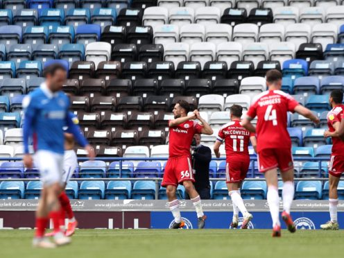 Accrington's Adam Phillips, second left, scored the only goal in the win at Portsmouth (Kieran Cleeves/PA)