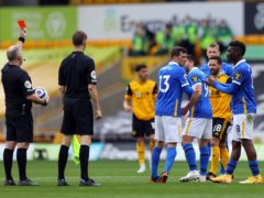 Neal Maupay, number nine, was sent off after the full-time whistle for Brighton at Wolves (Naomi Baker/PA)