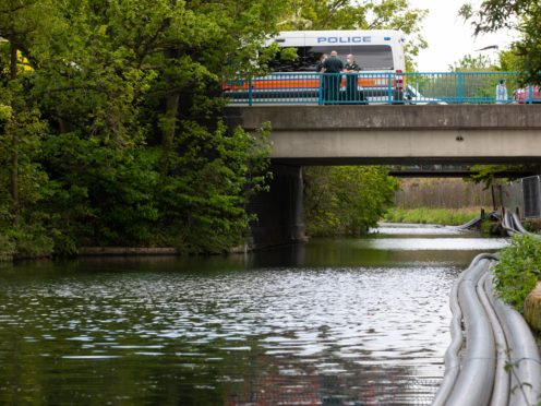 Emergency services on the Grand Union Canal near Old Oak Lane (David Parry/PA)