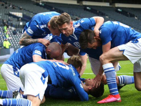 Glenn Middleton celebrates with team-mates after scoring his side's second goal of the game (Andrew Milligan/PA)